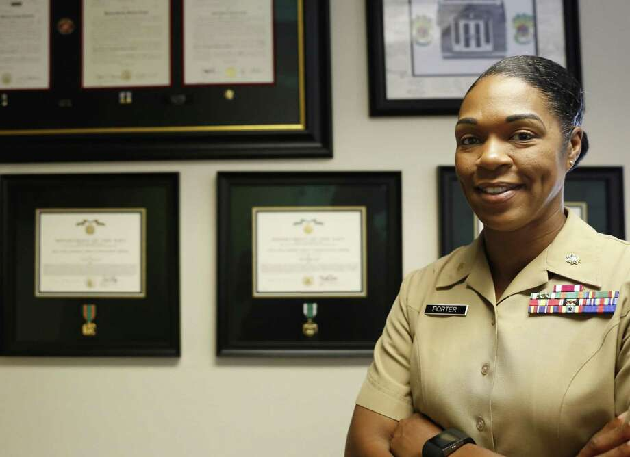 In this Aug. 5, 2016 photo, Maj. Shanelle Porter, commanding officer at the Recruiting Station Chicago poses in her office in Des Plaines, Ill. The U.S. Marine Corps is looking for a few more good women. And this time the campaign's a bit different. Marine recruiters are turning to girls high school sports teams to find candidates who may be able to meet the Corps' rigorous physical standards _ including for front-line combat jobs now open to women. (AP Photo/Tae-Gyun Kim) Photo: Tae-Gyun Kim, STF / Associated Press / Copyright 2016 The Associated Press. All rights reserved. This material may not be published, broadcast, rewritten or redistribu