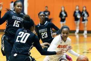 Gabby Connally is confronted by three defenders as she brings the ball upcourt in the second half as Brandeis plays Steele in class 6A third round playoff action at UTSA on February 21, 2017. (Staff photo)