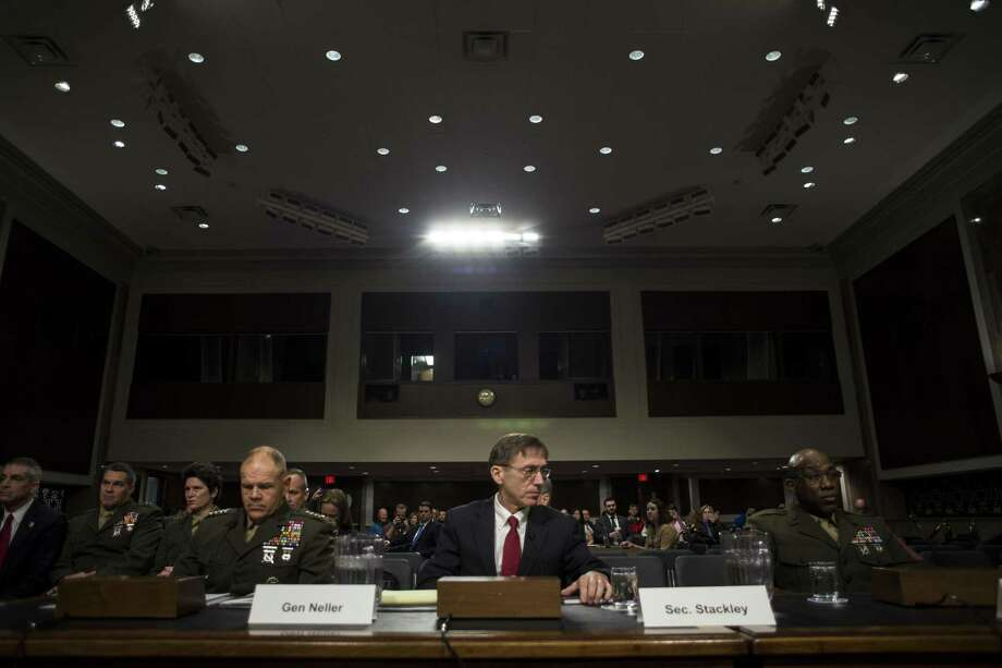Gen. Robert Neller, Commandant of Marine Corps, left, with Sean Stackley, acting secretary of the Navy, and Sgt. Maj. Ronald Green, Sergeant Major of the Marine Corps, testify on information surrounding the Marines United scandal during a Senate Armed Services hearing on Capitol Hill in Washington, March 14, 2017. (Gabriella Demczuk/The New York Times) Photo: GABRIELLA DEMCZUK, STR / NYT / NYTNS