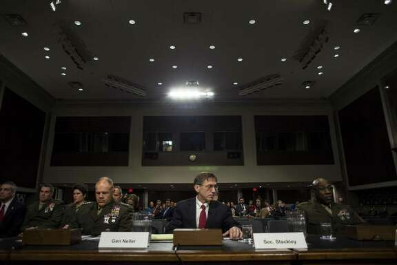 Gen. Robert Neller, Commandant of Marine Corps, left, with Sean Stackley, acting secretary of the Navy, and Sgt. Maj. Ronald Green, Sergeant Major of the Marine Corps, testify on information surrounding the Marines United scandal during a Senate Armed Services hearing on Capitol Hill in Washington, March 14, 2017. (Gabriella Demczuk/The New York Times)