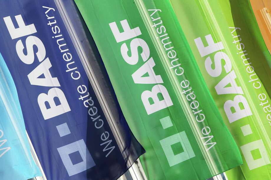 Flags with the logo of German chemicals company BASF flutter in front of the company's headquarters in Ludwigshafen, western Germany, on February 24, 2017. BASF said it expected higher oil prices to push up earnings this year after a challenging 2016, when its main Ludwigshafen plant was hit by a deadly explosion. / AFP PHOTO / Daniel ROLANDDANIEL ROLAND/AFP/Getty Images Photo: DANIEL ROLAND, Stringer / AFP or licensors