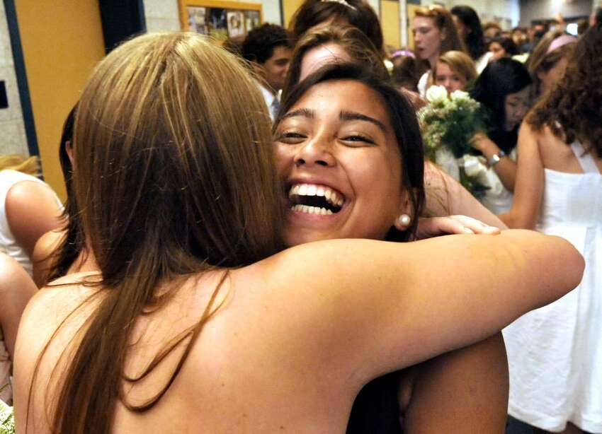 Keeshia Laus gets a hug from a fellow graduate during graduation exercises at Canterbury School in New Milford on Tuesday, June 1, 2010.