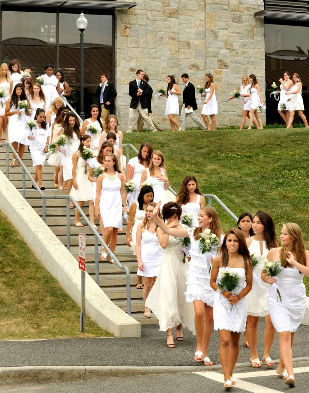 Graduating students walk from the chapel to the fieldhouse during graduation exercises at Canterbury School in New Milford on Tuesday, June 1, 2010.