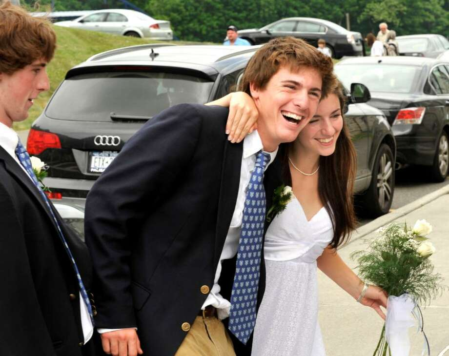 Graduating students Ethan Watt and Mackenzie Watt strike a pose as they walk from the chapel to the fieldhouse during graduation exercises at Canterbury School in New Milford on Tuesday, June 1, 2010. Photo: Michael Duffy / The News-Times