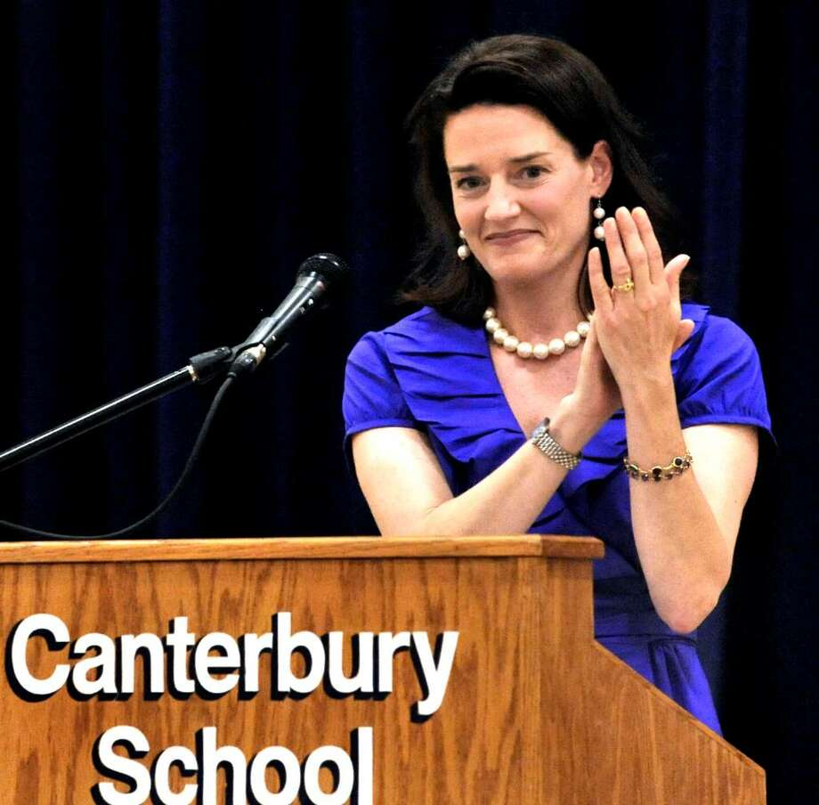 Graduation speaker Jay Clarke applauds the graduates during graduation exercises at Canterbury School in New Milford on Tuesday, June 1, 2010. Photo: Michael Duffy / The News-Times