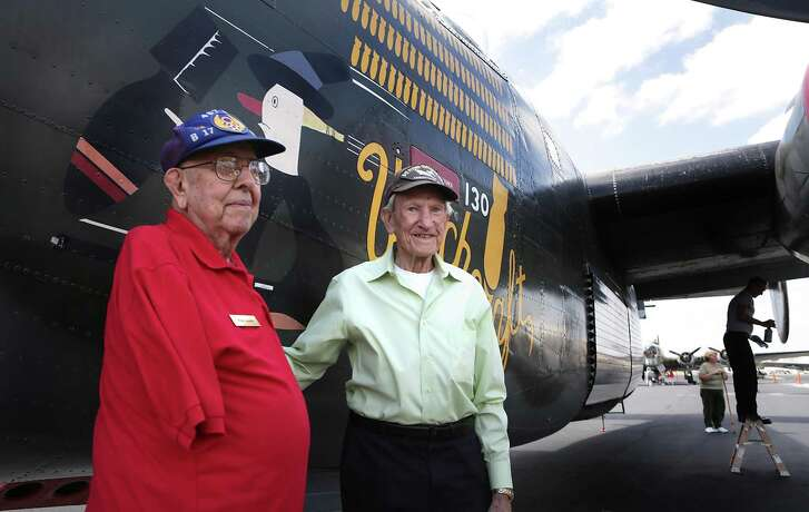 Vince Losada, left, and Earl Sampson both served in WWII, pose in front of a B-24J Liberator at the Wings of Freedom Tour display at Stinson Municipal Airport on Friday, March 17, 2017.  Losada, was a bombadier on a B-17 and lost his arm when the plane was hit by anti-aircraft, and Sampson was a navigator on a B-17. The display, which is open to visits and flights, will go on thru Sunday, March 19th.