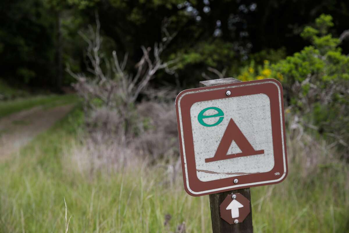 A trail sign pointing to a campsite is seen on Angel Island in San Francisco, California, on Sunday, March 19, 2017.