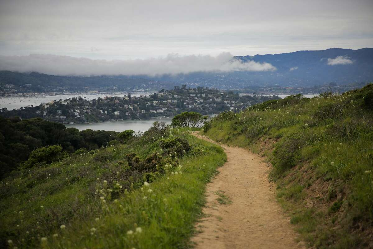 A trail on Angel Island in San Francisco, California, on Sunday, March 19, 2017.The epic crush of summer visitors at renowned recreation destinations across California is projected to continue through September and October - but could possibly abate come November.