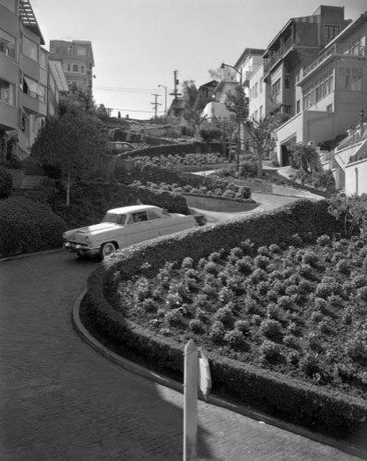 Aug. 10, 1955: A car travels down Lombard Street in San Francisco.