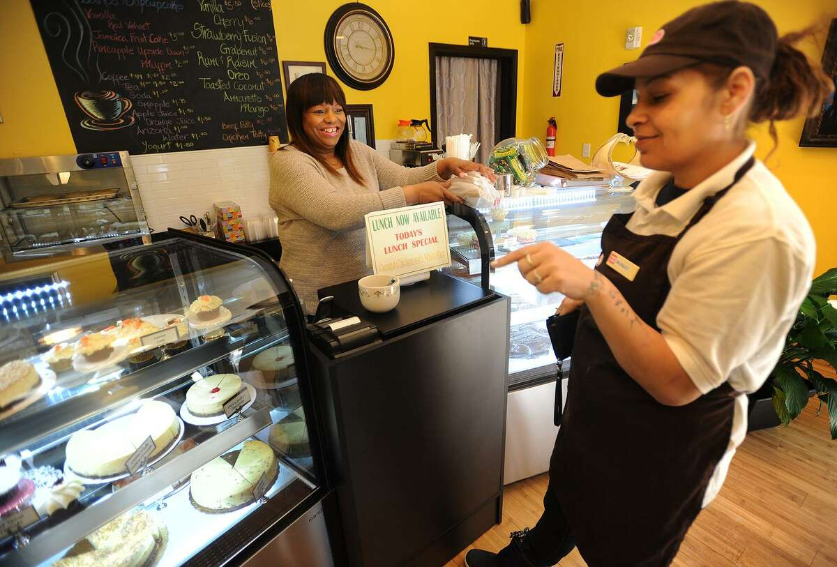 Sandra Williams waits on customer Monica Ropiza as she picks out a slice of cheesecake at La Signature Cheesecakes in the Arcade Mall at 1001 Main Street in downtown Bridgeport, Conn. on Thursday, March 16, 2017.