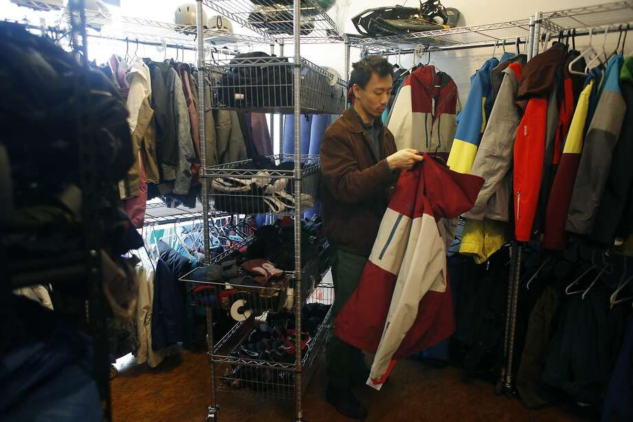Owner James Dong organizes camping gear for rent at Last Minute Gear in San Francisco. Photo: Lea Suzuki, The Chronicle