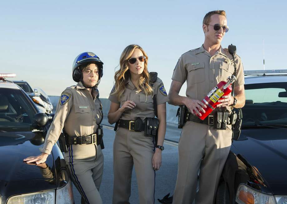 """Rosa Salazar (left) Jessica McNamee and Jess Rowland play California Highway Patrol officers in """"Chips,"""" a course-comic movie version of the TV series that aired from 1977-1983. Photo: Peter Iovino, Associated Press"""