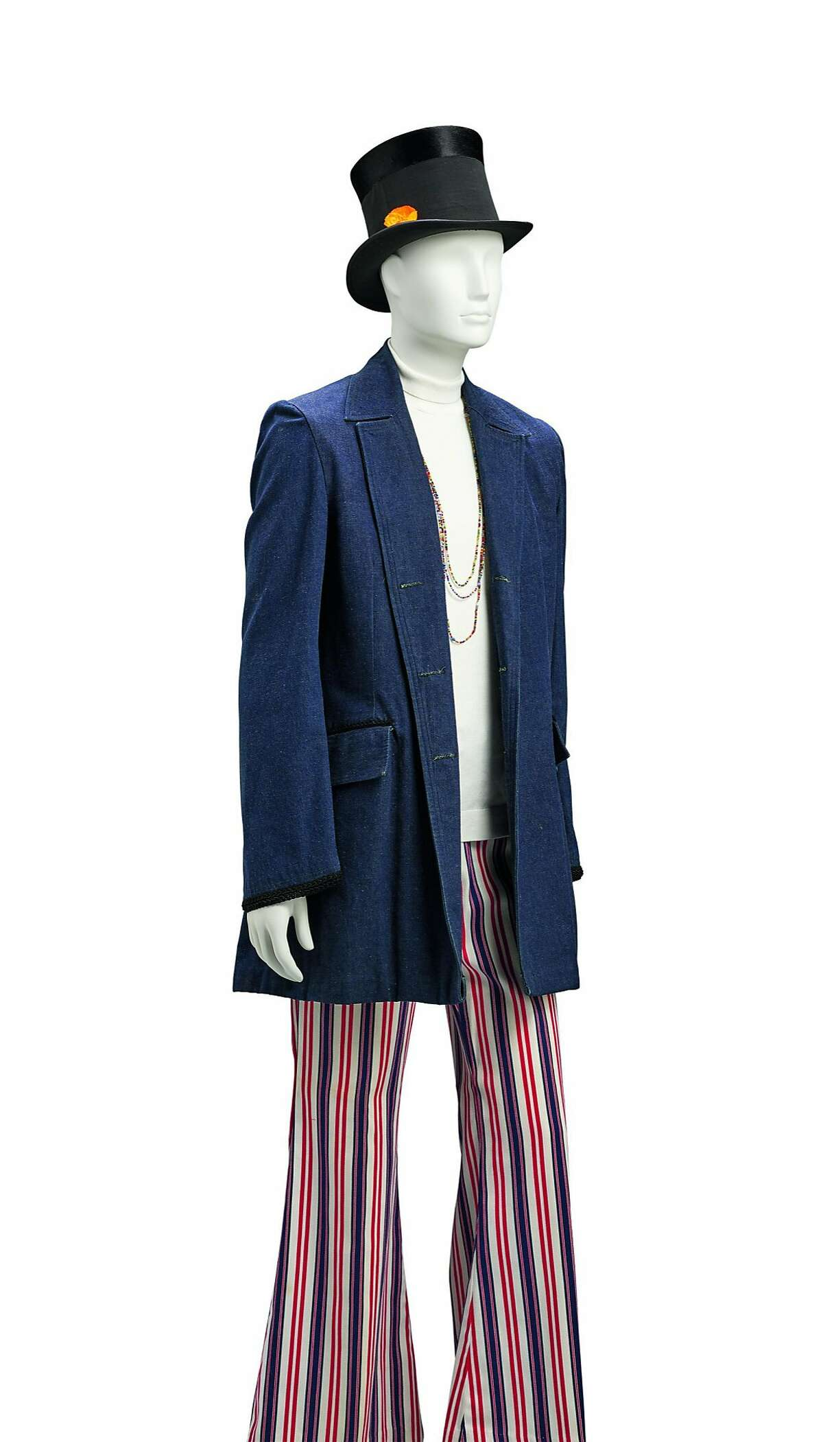 Jeanne Rose, jacket, ca. 1969. Denim with braid trim. Collection of the artist. Pants, ca. 1969. Striped cotton twill. Collection of Decades of Fashion. John W. Loader, top hat, 1903. Silk plain weave, beaver fur, and leather. Fine Arts Museums of San Francisco, Gift of Miss Evelyn Erickson. Image Courtesy of the Fine Arts Museums of San Francisco