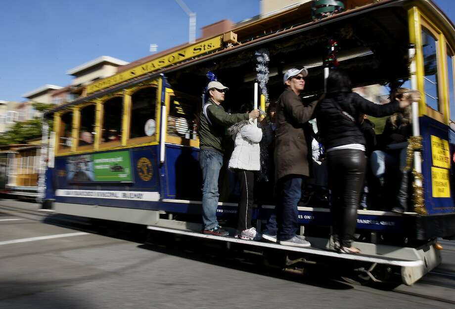 Tourists and locals enjoyed the Mason Street line of the cable car as it made its start up Taylor Street. This month is turning out to be one of the driest on record in the San Francisco Bay Area, which is not good for the water supply, but great for playing outside. Photo: Brant Ward, The Chronicle