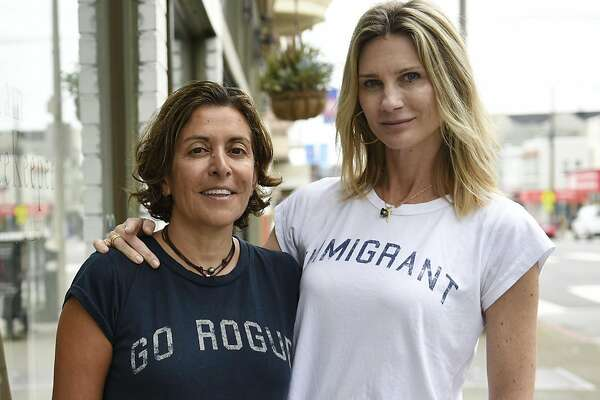 Road 22 co-founders Fit Ghobadian, left, and Alice Cahan pose for a portrait in front of William the Beekeeper, a clothing store that shares an office space with the social aware clothing maker, in San Francisco, CA, on Monday March 20, 2017.
