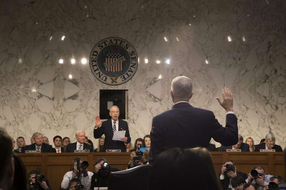Neil Gorsuch is sworn in on the first day of his confirmation hearing before a Senate committee. Photo: STEPHEN CROWLEY, NYT