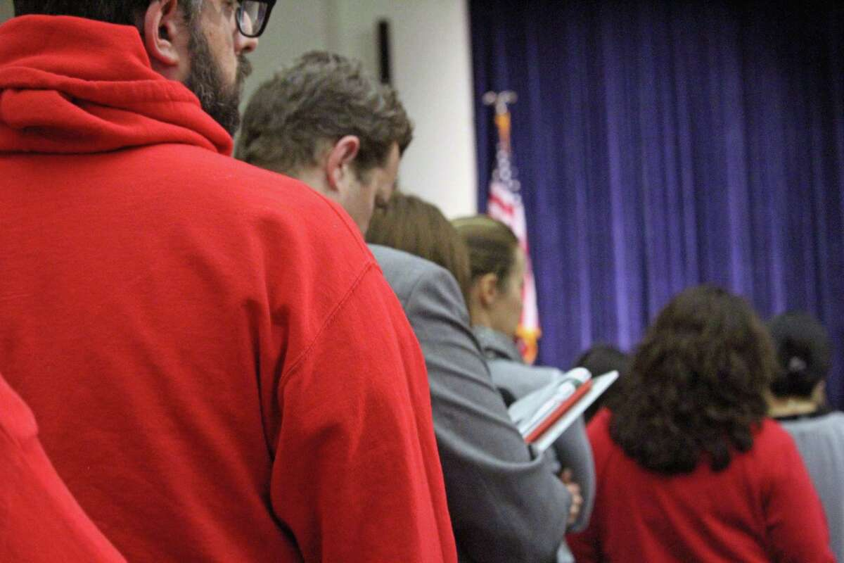 Residents wait in line Saturday to air their opinion on the proposed $308 million municipal budget.