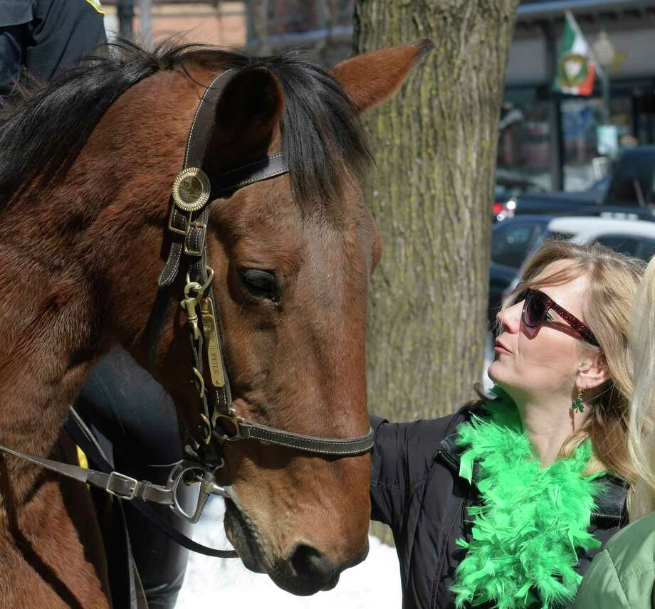 Mounted Officer Jupiter with rider officer Aaron Moore gets some love from the public on his final tour of duty on Broadway before retirement Friday March 17, 2017 in Saratoga Springs, N.Y.  (Skip Dickstein/Times Union) Photo: SKIP DICKSTEIN / 20039999A