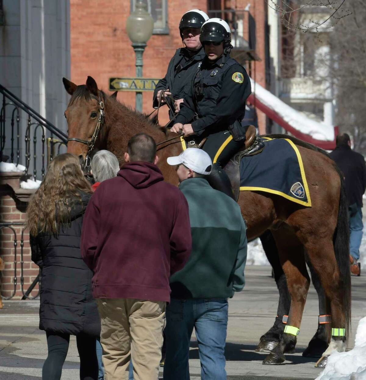 Mounted Officer Jupiter with rider officer Aaron Moore goes out for his final tour of duty on Broadway before retirement Friday March 17, 2017 in Saratoga Springs, N.Y. Accompanying Jupter and Moore is Mounted officer King Tut with rider officer John Sesselman. (Skip Dickstein/Times Union)