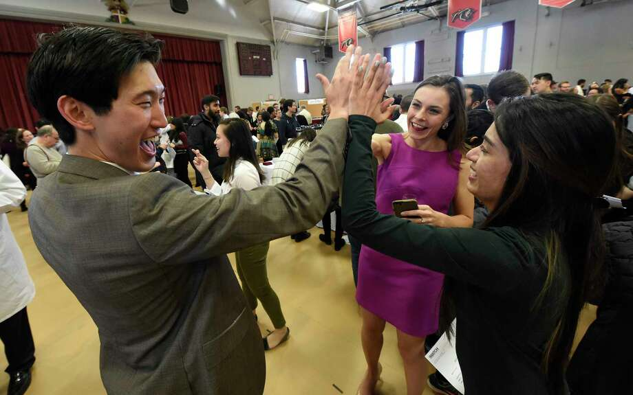 A high five for these 4th year medical students at Match Day for the Albany Medical College Friday March 17, 2017 in Albany, N.Y. The students that received their residency and will remain in Albany are, Daniel Lee, left,  Kate Williams, center and Bhumi Patel, right.   (Skip Dickstein/Times Union) Photo: SKIP DICKSTEIN / 20039990A