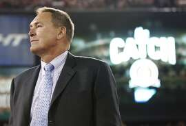 "FILE - In this Dec. 23, 2013, file photo, former San Francisco 49ers wide receiver Dwight Clark is honored at halftime of an NFL football game between the 49ers and the Atlanta Falcons in San Francisco. Clark stands near the spot where he made a catch so famous it is referred to as ""The Catch.""  Clark says he has Lou Gehrig�s disease and suspects playing football might have caused the illness. Clark announced Sunday, March 19, 2017. on Twitter that he has amyotrophic lateral sclerosis, a disease that attacks cells that control muscles. Clark linked to a post on his personal blog detailing his ALS diagnosis, but the site crashed Sunday night, apparently from an overflow of traffic. (AP Photo/Tony Avelar, File)"