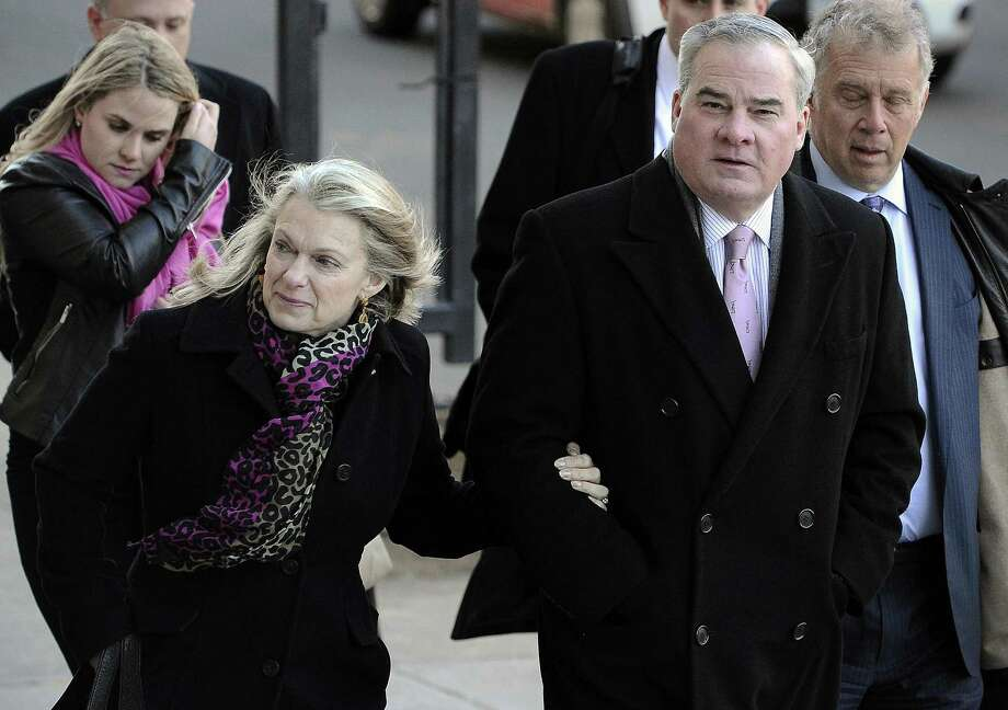 Former Connecticut Gov. John Rowland, right, and his wife, Patty, arrive at federal court in New Haven, Conn. on March 18, 2015. The U.S. Supreme Court has declined to hear Rowlands appeal of his convictions for conspiring to hide his work on two congressional campaigns after having gone to prison for corruption. Photo: Jessica Hill / Associated Press File / FR125654 AP