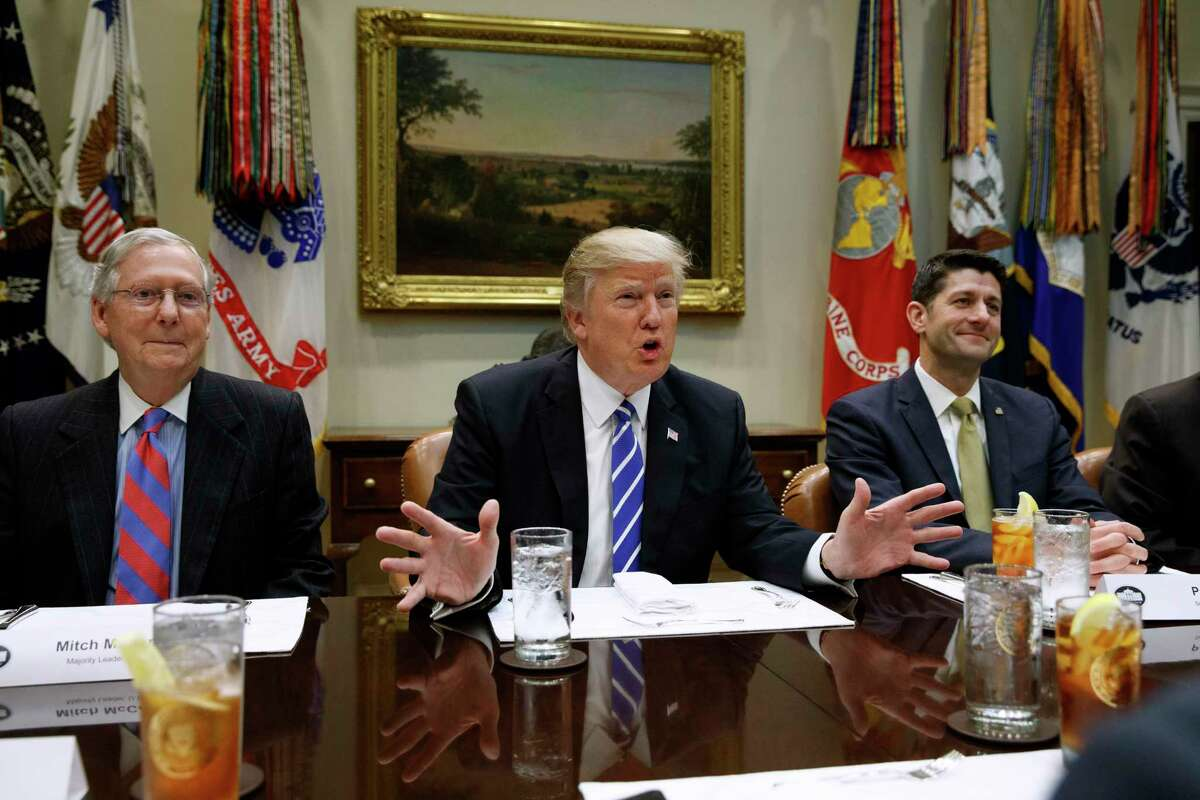 This Wednesday, March 1, 2017, file photo shows President Donald Trump, flanked by Senate Majority Leader Mitch McConnell of Ky., left, and House Speaker Paul Ryan of Wis., right as he speaks during a meeting with House and Senate leadership in the Roosevelt Room of the White House in Washington. The president attempted to deploy an outside and inside strategy to fulfill his campaign promise to repeal and replace