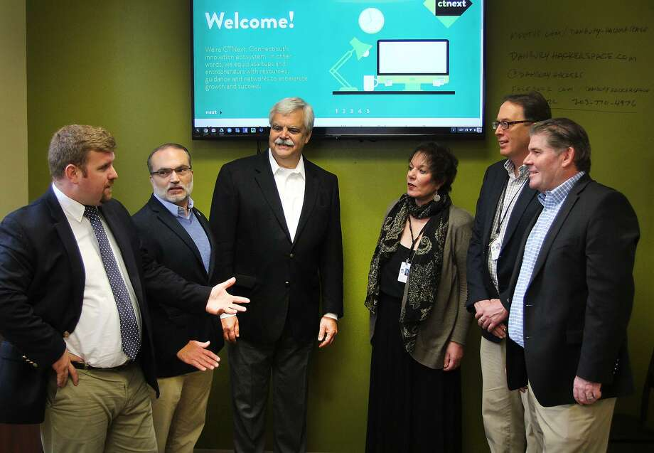 Some of the major players involved in Danbury receiving an innovation planning grant gathered Thursday, Oct. 27, 2016, at the Danbury Hackerspace to discuss the next steps of the process. The group included, left to right: PJ Prunty of CityCenter; Roger Palanzo of the Business Advocacy; state Rep. Bob Godfrey; Pauline Assenza of Western Connecticut State University; Mike Kaltschnee of Danbury Hackerspace; and Steve Bull of the Greater Danbury Chamber of Commerce. Photo: Chris Bosak / Hearst Connecticut Media / The News-Times