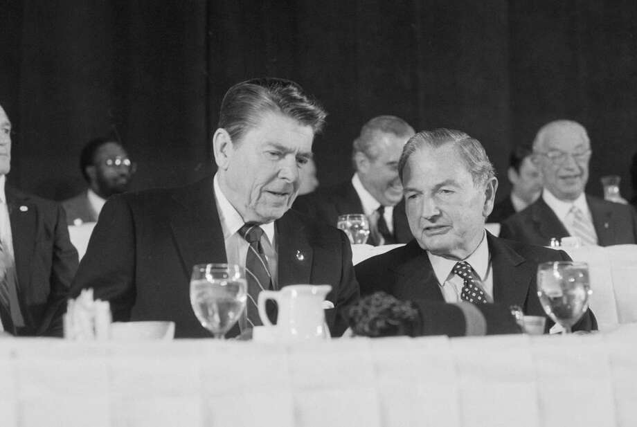 President Ronald Reagan huddled with David Rockefeller at a 1982 luncheon in New York City. Reagan jokingly denied he was lunching with Rockefeller to ease federal budget problems. Photo: Bettmann Archive 1982 / Bettmann Archive 1982 / This content is subject to copyright.