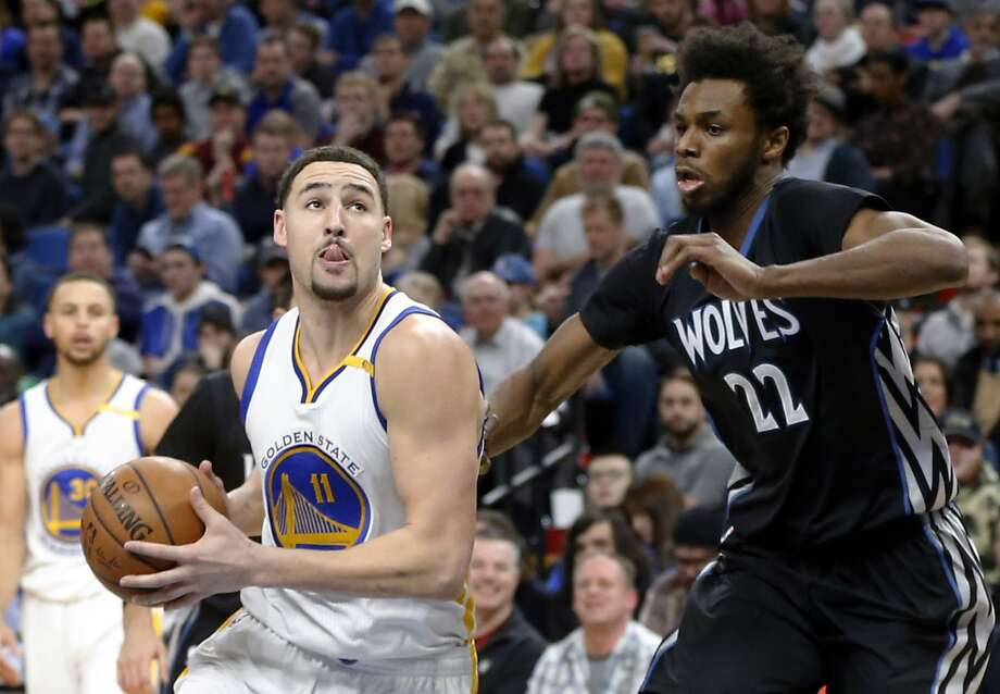 Golden State Warriors' Klay Thompson, left, drives on Minnesota Timberwolves' Andrew Wiggins during the second half of an NBA basketball game Friday, March 10, 2017, in Minneapolis. The Timberwolves won 103-102. Thompson and Wiggins led their teams in scoring. (AP Photo/Jim Mone) Photo: Jim Mone, Associated Press