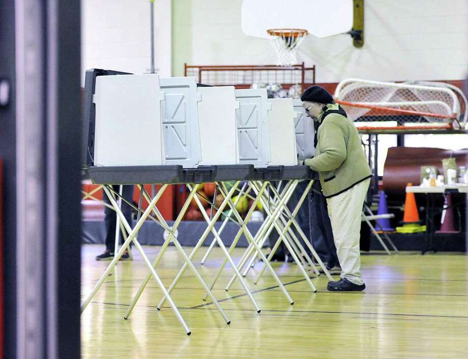 A voter casts her ballot in the gymnasium inside New Lebanon School in 2015. The League of Women Voters is co-sponsoring a discussion on a national move to circumvent the Electoral College and award the presidency to the person who garners the most votes. The discussion is set for 7 p.m. April 4 at the Greenwich Library, 101 W. Putnam Ave. Free and open to the public. Photo: Bob Luckey Jr. / Hearst Connecticut Media / Greenwich Time