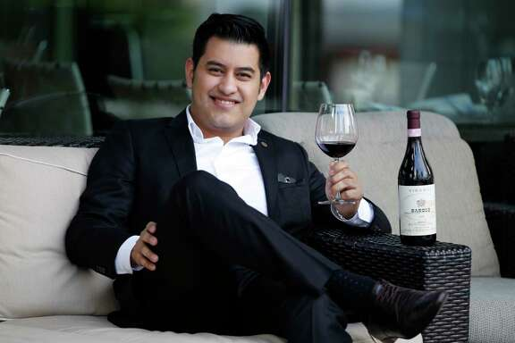 Andres Blanco poses for a portrait with his favorite wine Barolo 2006 on Friday, Feb. 10, 2017, in Houston. ( J. Patric Schneider / For the Chronicle )
