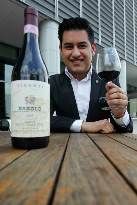 Caracol sommelier Andres Blanco touts his favorite wine, the 2006 Viberti Giovanni Bricco delle Viole Riserva Barolo. Photo: J. Patric Schneider, Freelance / © 2017 Houston Chronicle