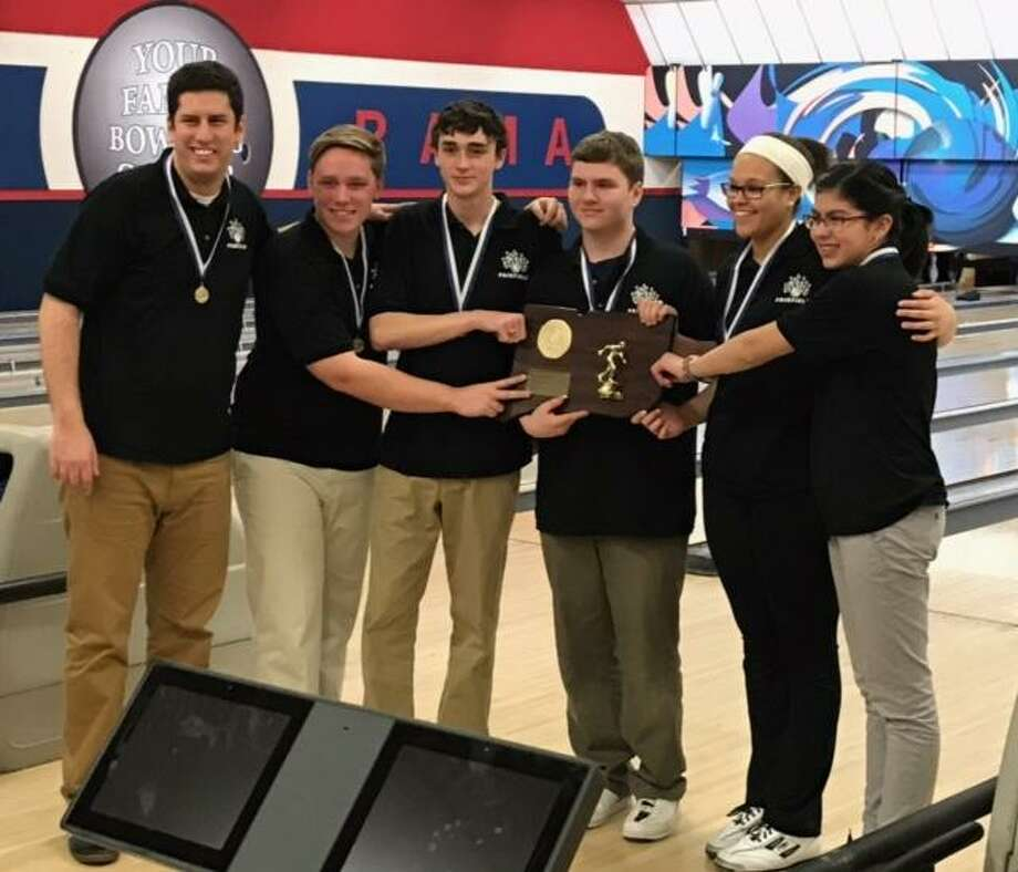 Coach Brendan Puskar, left and the members of the Fairfield co-op bowling team pose with the state championship trophy after winning its second straight title at the Rowl-A-Rama in Newington. Photo: Contributed / Contributed