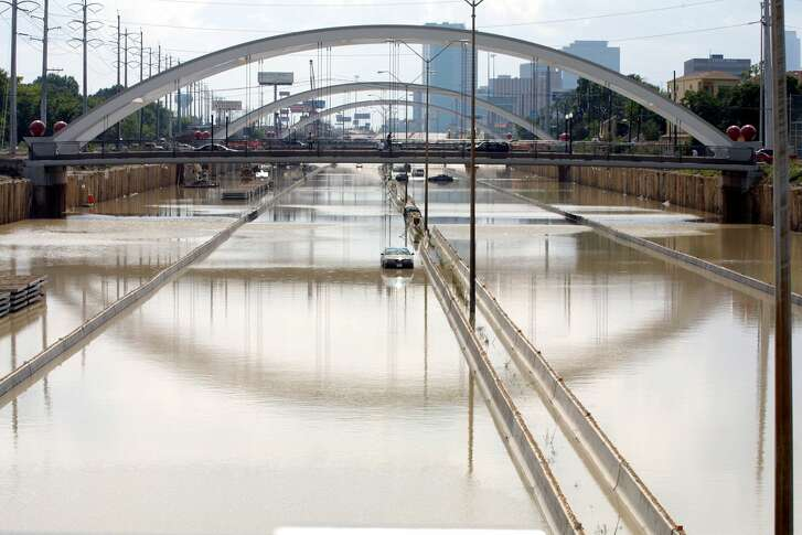 HOUSTON, UNITED STATES:  US Highway 59 is still impassable 10 June 2001 in Houston, Texas, due to rain from tropical storm Allison.  Thousands of people in Texas and Louisiana  were temporarily homeless after being forced to flee flooding caused by four days of torrential rains. The American Red Cross blamed at least seven deaths on the violent weather, the aftermath of tropical storm Allison.   AFP PHOTO/James NIELSEN (Photo credit should read JAMES NIELSEN/AFP/Getty Images)