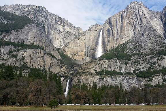Multi-tiered Yosemite Falls, recharged by rain and snowmelt, and photographed from Sentinel Meadow, is one of several waterfalls that has turned Yosemite Valley into the showpiece of the world.