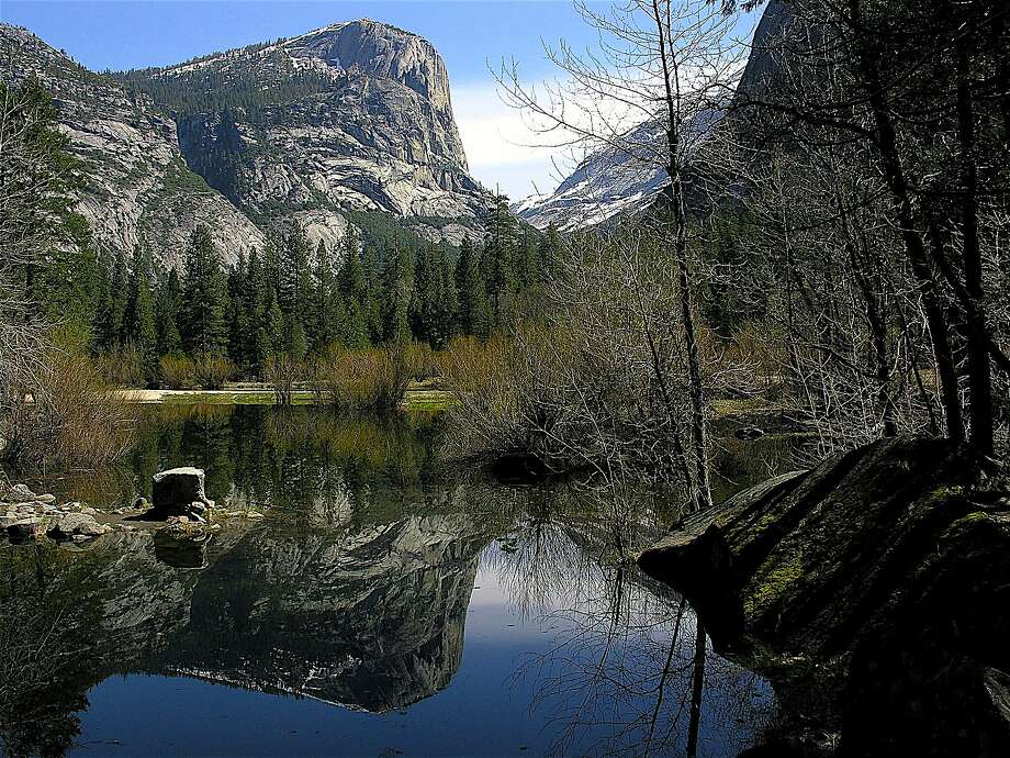 Mirror Lake at the foot of Half Dome in Yosemite National Park reflects Mount Watkins. Photo: Tom Stienstra, Courtesy National Park Service
