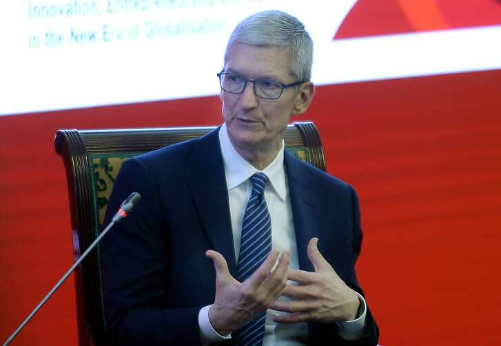 Apple CEO Tim Cook speaks as he attends the Economic Summit during the China Development Forum in Beijing, China, Saturday March 18, 2017. (Chinatopix via AP)