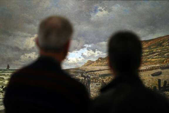 Viewers attend the  Fine Arts Museums of San Francisco's Monet: The Early Years exhibit at Legion of Honor in San Francisco, Calif., on Sunday, March 19, 2017.