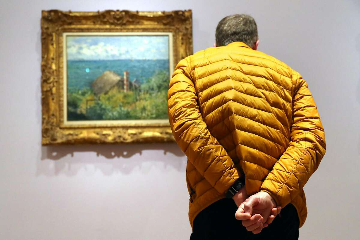 John McKee views a painting as Fine Arts Museums of San Francisco present Monet: The Early Years at Legion of Honor in San Francisco, Calif., on Sunday, March 19, 2017.