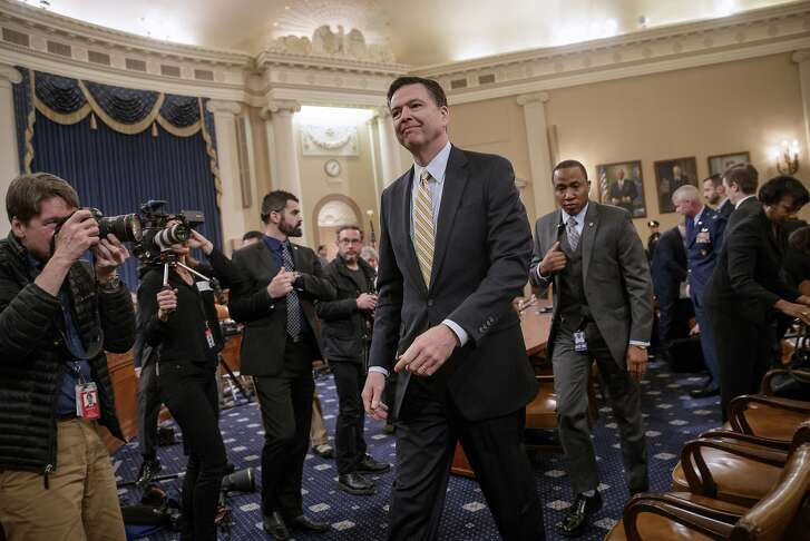 FBI Director James Comey takes a break after three hours of testifying on Capitol Hill in Washington, Monday, March 20, 2017, before the House Intelligence Committee hearing on allegations of Russian interference in the 2016 U.S. presidential election.  (AP Photo/J. Scott Applewhite)