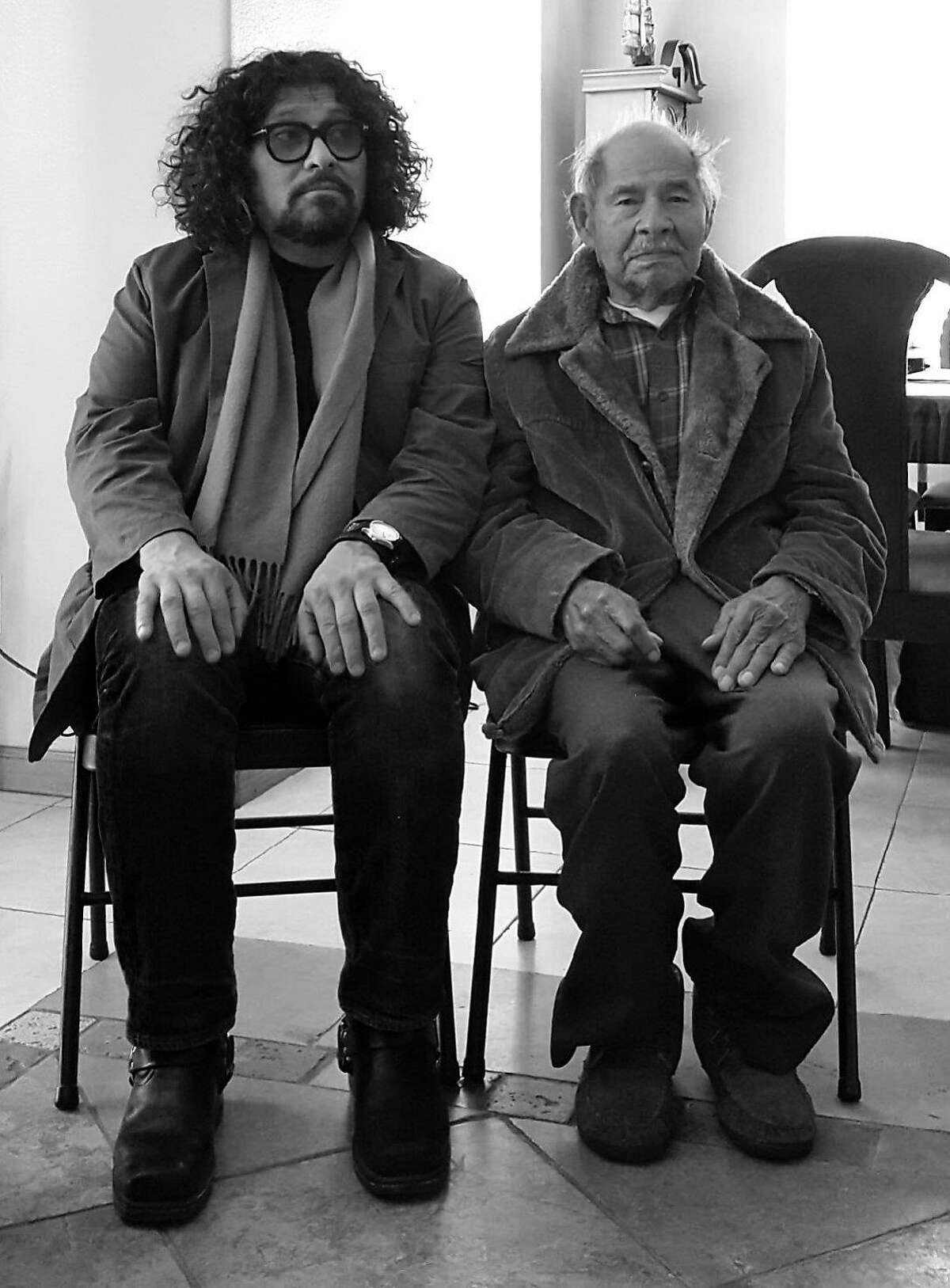 Victor Cartagena (left) with 101-year old former farm worker Maurillo Maravilla, the model for Cartagena's work