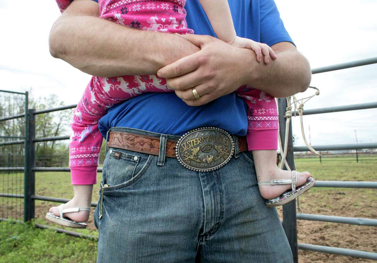 Justin Davis, a roping competitor, holds his daughter Shyla at the Rodeo Village, Wednesday, March 8, 2017, in Houston. ( Jon Shapley / Houston Chronicle )