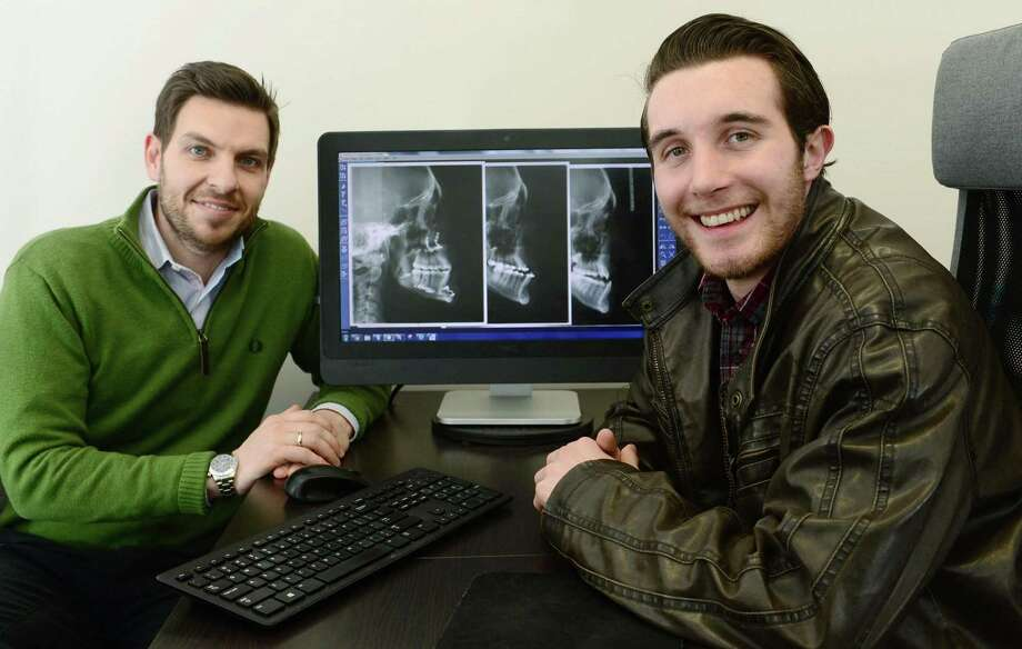 Dr. Steve Giannoutsos, a Norwalk orthodontist, and his patient David Rodriguez Friday, March 10, 2017, at Giannoutsos' offices in Norwalk, Conn. Rodriguez recently underwent a facial reconstruction to correct a severe underbite that impaired his chewing and overall quality of life. Giannoutsos has partnered with a Yale surgeon to utilize 3D imaging for facial reconstruction surgeries as was done in the Rodriguez case. Photo: Erik Trautmann / Hearst Connecticut Media / Norwalk Hour