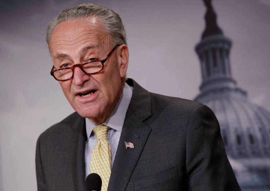 Senate Minority Leader Chuck Schumer of N.Y. speaks to reporters on Capitol Hill in Washington, Thursday, March 2, 2017, about news reports of Attorney General Jeff Sessions' contact with Russia's ambassador to the U.S. during the presidential campaign. The revelation is spurring growing calls in Congress in both parties for him to recuse himself from an investigation into Russian interference in the U.S. election. (AP Photo/J. Scott Applewhite) Photo: J. Scott Applewhite, STF / AP