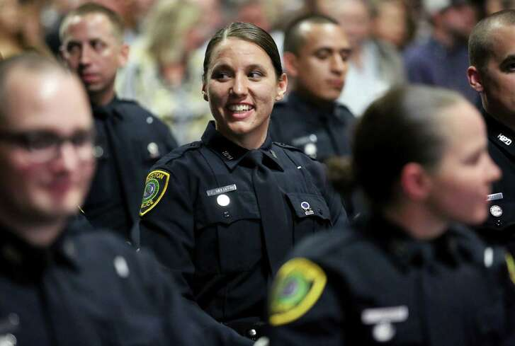 A Houston Police Deparatment Class #229 cadet smiles as she and her   classmates prepare to receive their badges during graduation at  the Houston Police Academy, L.D. Morrison Sr. Memorial Center, Thursday, March 16, 2017, in Houston. ( Yi-Chin Lee / Houston Chronicle )