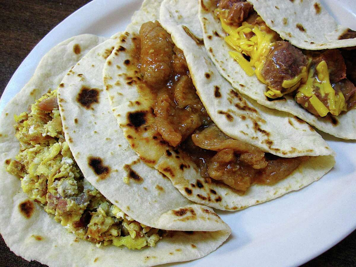 Bacon and egg, spicy chicharrones and carne guisada with cheese tacos on handmade flour tortillas from Mittman Fine Foods.