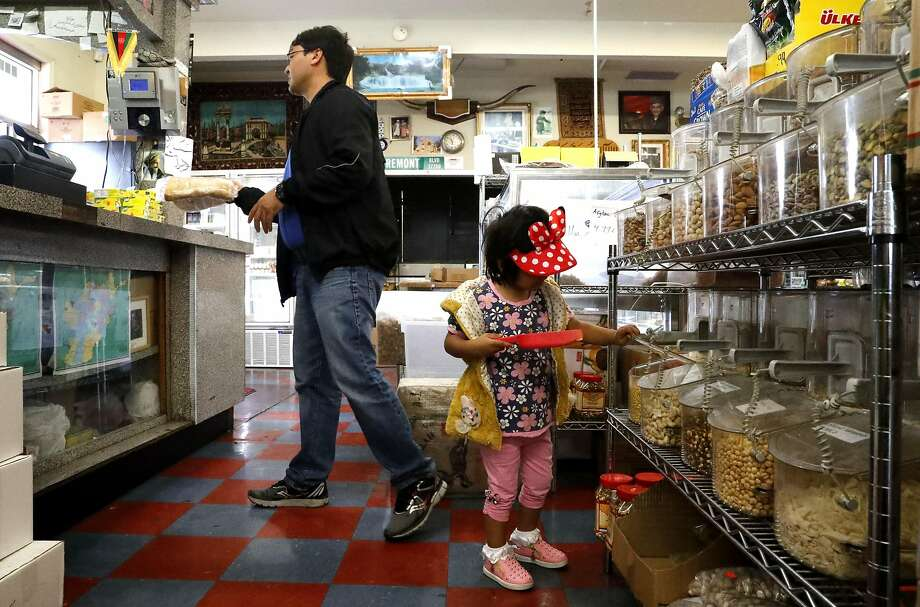 Mohammad Reza and his daughter Hosna, 3, shop at Maiwand Market in Fremont. Photo: Michael Macor, The Chronicle