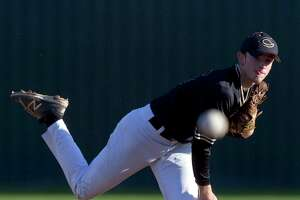 Conroe starting pitcher Marshall Prether (16) throws during the first inning of a District 12-6A high school baseball game at Elmore Field on Tuesday, March 14, 2017, in Conroe.