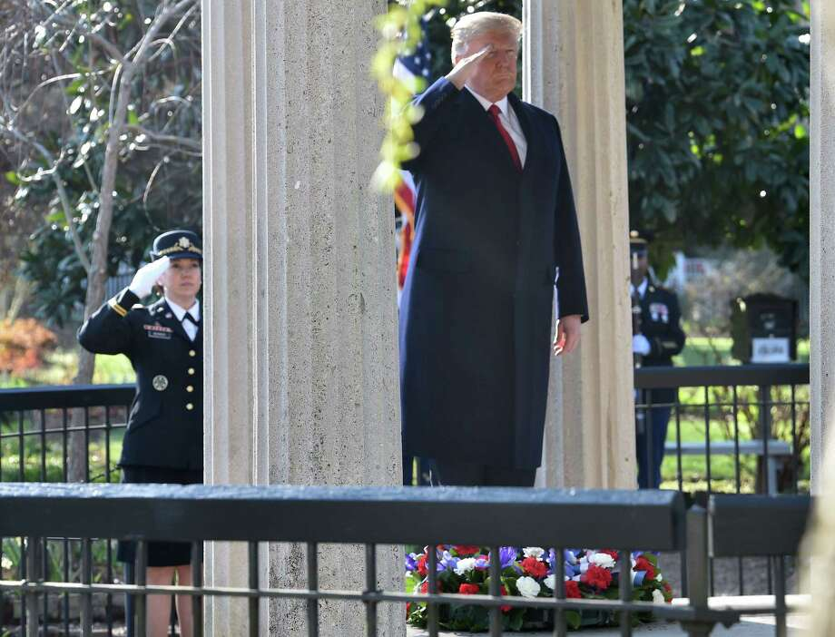 President Donald Trump salutes after laying a wreath at the tomb of former President Andrew Jackson. Jackson was badly wrong on the largest issue of his time: the dignity of people of color. Photo: Nicholas Kamm / AFP / Getty Images / AFP or licensors